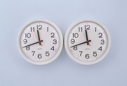 These Two Identical Adjacent Battery Operated Clocks Were Initially Set To The Same Time But With Time They Will Inevitably Fall Out Of Sync
